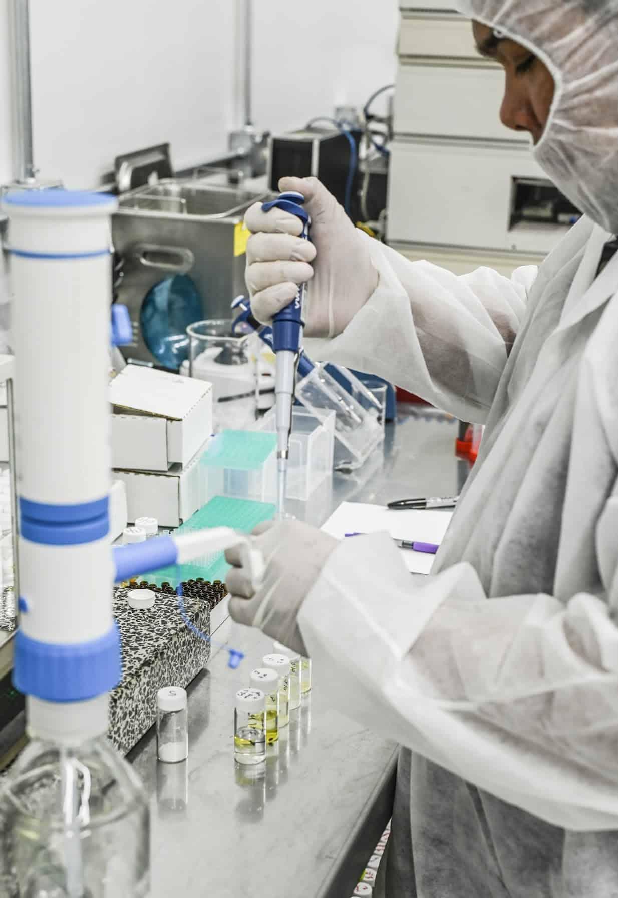 scientist using chromatography equipment