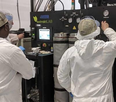 scientist works on extraction machine